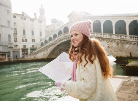 Woman tourist with map near