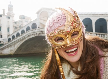 Happy woman holding Venice Mask