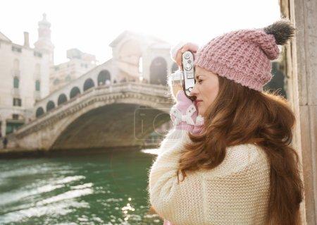 Woman tourist taking photos with