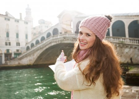 Happy young woman tourist with