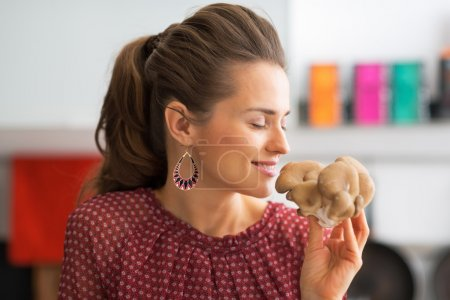 Photo for Portrait of young housewife smelling oyster mushrooms - Royalty Free Image