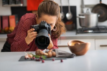 Young woman photographing food