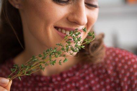 Closeup on young housewife enjoying fresh thymus