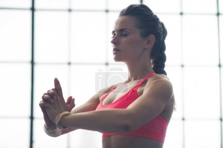 Woman doing yoga pose upper body only