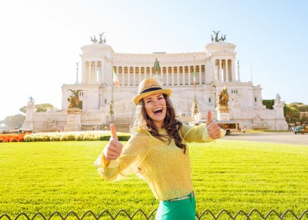 Smiling woman gives two thumbs up at Venice Square in Rome
