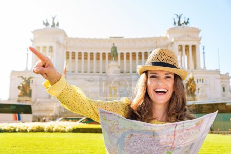 Laughing woman pointing while holding map at Venice Square