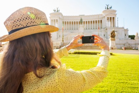 Woman seen from behind taking photo of Venice Square
