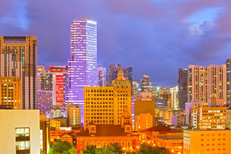 Photo for SUnset over Miami Florida skyline with illuminated modern buildings of downtown financial district and brickell - Royalty Free Image