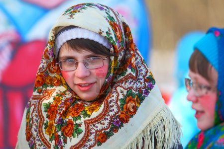 The girl in a national Russian dress.