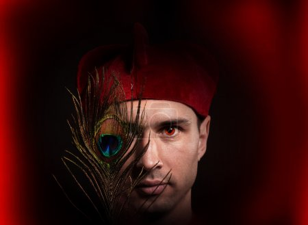 Fantasy style portrait of an inquisitor with fire in his eyes and a peacock feather in front of his face
