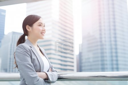 Photo for Business woman smile and look with office background, asian beauty, shot in Hong Kong - Royalty Free Image