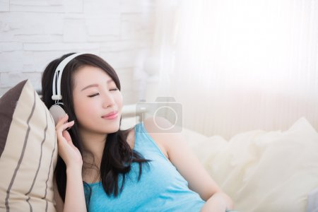 woman enjoying the music and relaxing