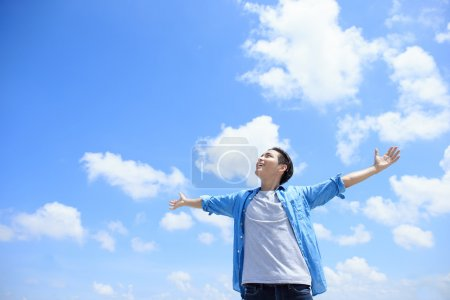 Photo for Carefree and free man with raised hands  looking to a sky, asian - Royalty Free Image