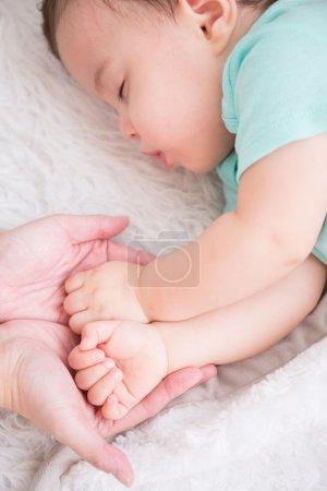 Baby sleep on the bed