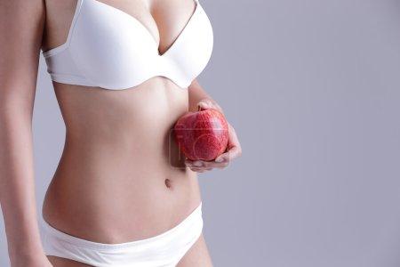 woman holding  apple