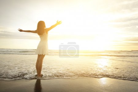 Photo for Smile Freedom and happiness woman on beach. She is enjoying serene ocean nature during travel holidays vacation outdoors. asian beauty - Royalty Free Image