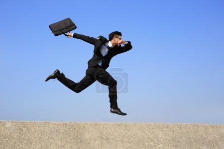 Happy business man running