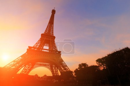 Photo for Sunset over silhouette of eiffel tower in Paris - Royalty Free Image
