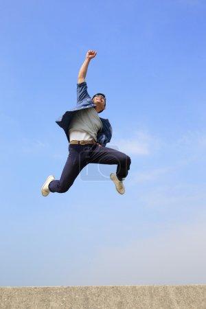 Happy man jumping