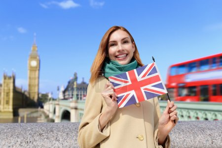 woman holding British  flag