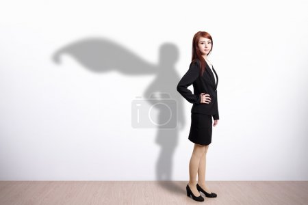 Photo for Superhero Business Woman with white wall background, great for your design or text, asian - Royalty Free Image