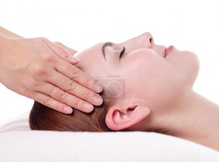 Woman enjoying face massage
