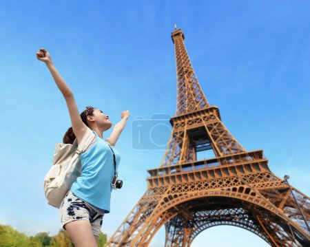 Happy  woman in Paris with Eiffel Tower on backgro...