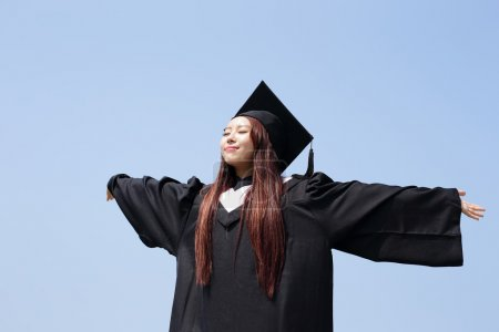 Photo for Happy graduate student with her hands outstretched - Royalty Free Image