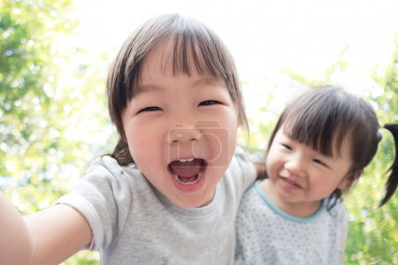 Happy child taking a selfie