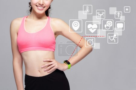 Woman wearing smart watch device with health icons...
