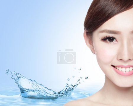Photo for Beauty Skin care concept, Beautiful woman face with Water splashes isolated on blue background, asian model - Royalty Free Image