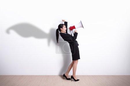 Superhero business woman screaming