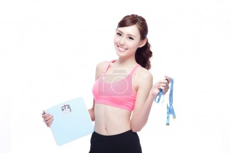 Sport girl hold weight scale