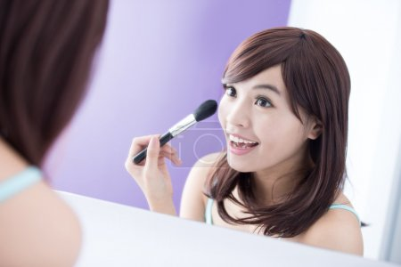 woman using  makeup brush