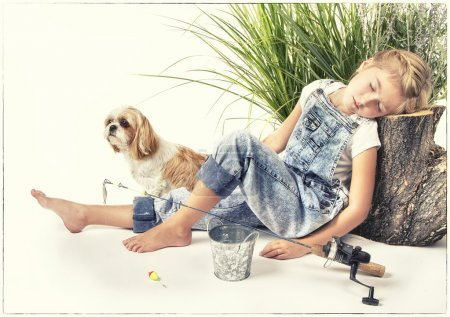 Child or young girl with her dog taking a nap or sleeping while