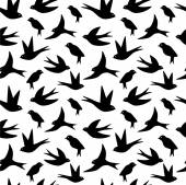 Seamless pattern made of swallow birds