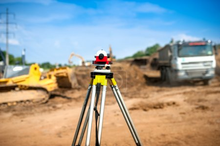 Surveyor equipment optical level or theodolite at construction site