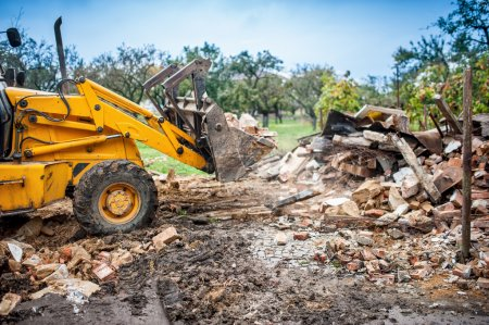 Hydraulic bulldozer crusher, industrial excavator machinery working on site demolition