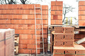 Wall building with professional bricks, construction site of new house