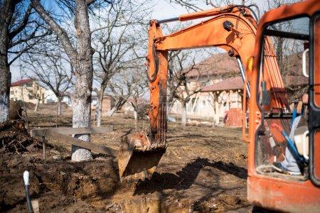 track-type loader excavator digging house foundation