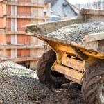 Dumper truck unloading construction gravel, sand a...