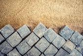 Construction of pavement details, cobblestone pavement, stone blocks on road construction site
