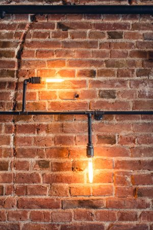 home decoration walls with lamps, pipes and bricks. Old and vintage looking wall, interior design