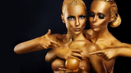 Woman with golden Body Art productions.