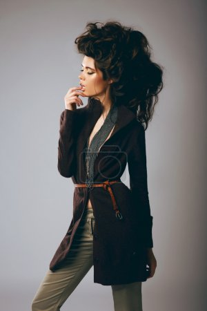 Vogue Style. Classy Fashion Model in Stylish Brown Jacket and Pants