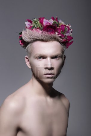 Fantasy. Styled Albino Man with Flowers