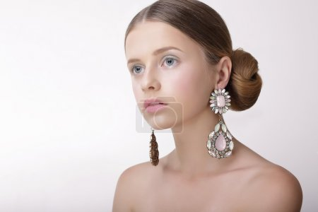 Luxury. Sophisticated Woman with Pearly Earrings with Diamonds