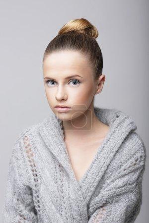 Studio Portrait of Young Female in Gray Woolen Cardigan