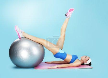 Aerobics. Sportswoman in Sport Club with Fitness Ball