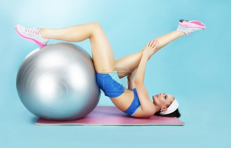 Wellness Concept. Woman in Sportswear with Sport Equipment